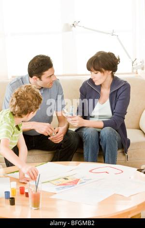 parents talking about money - Stock Photo