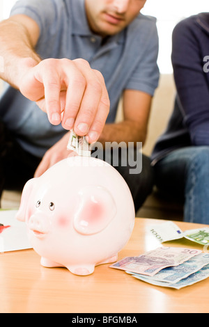 couple saving money - Stock Photo