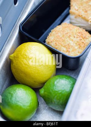 Lime, lemon and codfish, close-up, Sweden. - Stockfoto