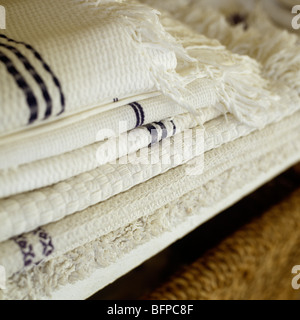 A pile of folded cotton towels and linen - Stock Photo