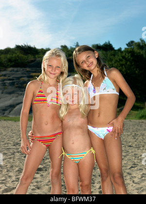 Portrait of siblings at the beach - Stock Photo