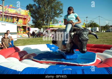 girl rides rodeo boy machine