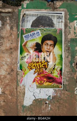 Shahruk Khan in torn Bollywood movie poster on wall, Hospet, Karnataka, India, Asia - Stock Photo