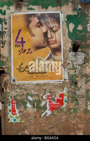 Bollywood movie poster on wall, Hospet, Karnataka, India, Asia - Stock Photo
