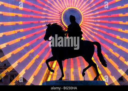 Statue of Louis XIV during the Festival of Lights (Ferris wheel in Background), Place Bellecour, Lyon, France - Stock Photo