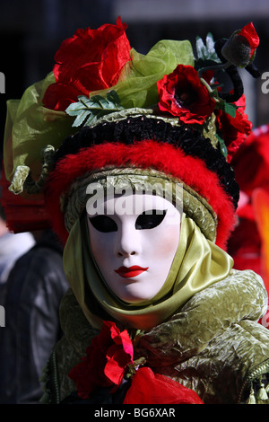 Venetian woman wearing a mask and costume in Venice Carnival 2009 - Stock Photo