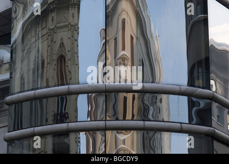 Reflection of old building on new building, Belgrade - Stock Photo