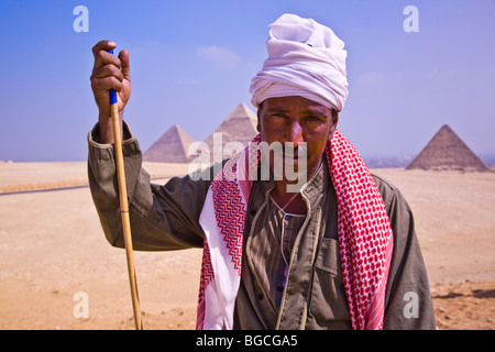 Close up of a male Egyptian camel driver who gives camel rides at the Pyramids of Giza near Cairo Egypt - Stock Photo