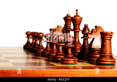 black chess pieces on a chessboard in starting position - Stock Photo