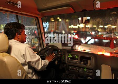 A taxi driver honking in a traffic jam, Dubai, United Arab Emirates - Stock Photo