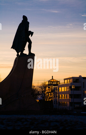 Statue of Leifur Eiriksson (Leif Ericson) at sunset. In front of Hallgrimskirkja church, downtown Reykjavik, Iceland. - Stock Photo