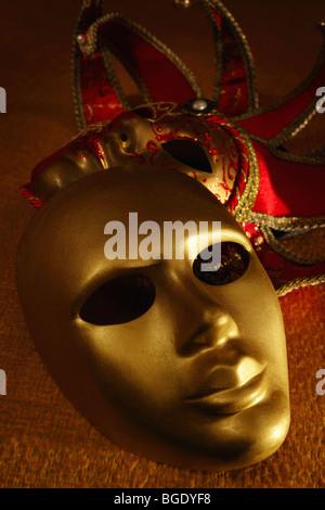 venetian masks on a textile - Stock Photo