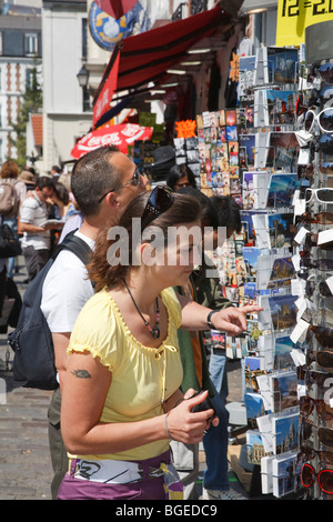Tourists shop for postcards and sunglasses in Paris, France - Stock Photo