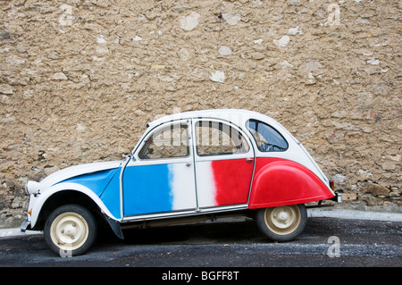 citroen 2cv or french deux chevaux auto red white and blue with woman stock photo royalty free. Black Bedroom Furniture Sets. Home Design Ideas