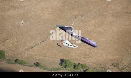 A hand glider enjoys the favorable flying conditions often found around Te Mata Peak in Hawkes Bay. - Stock Photo