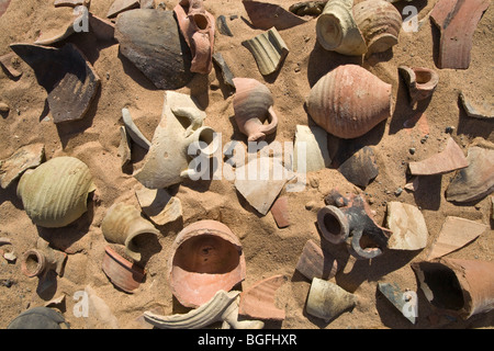 Piles of ancient pottery shards on the desert floor at Daydamus Roman Fort in the Eastern Desert of Egypt , North - Stock Photo