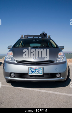 2004 toyota prius has a 56 mpg custom license plate people pay for stock photo royalty free. Black Bedroom Furniture Sets. Home Design Ideas