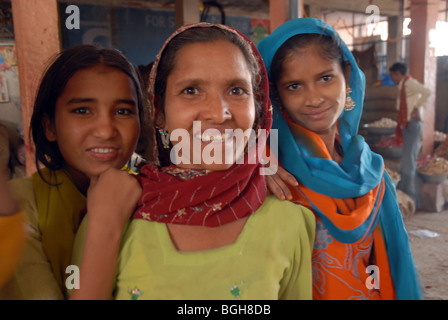 Three (3)women from the same family at a market in Rajasthan - Stock Photo
