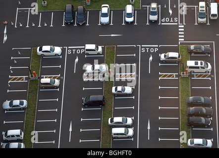 Aerial view of car park with less than half the spaces taken - Stock Photo