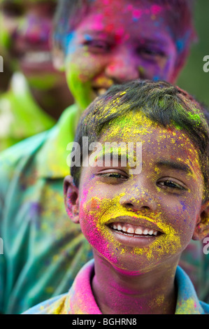 Young Indian boys covered in coloured powder pigment. India - Stock Photo