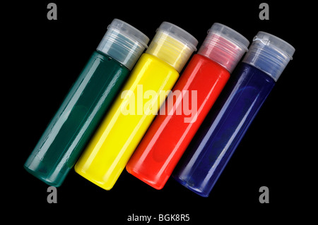 Tubes of colorful face paint isolated on black background - Stock Photo