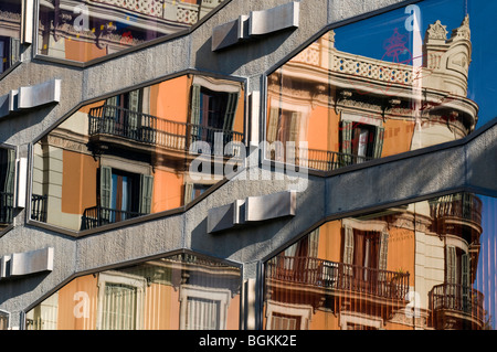 New and old buildings' reflection in Plaça de Urquinaona, Barcelona, Catalonia, Spain - Stock Photo