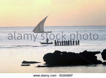 African fisherman pulling in a net - Tanzania Africa - Stock Photo
