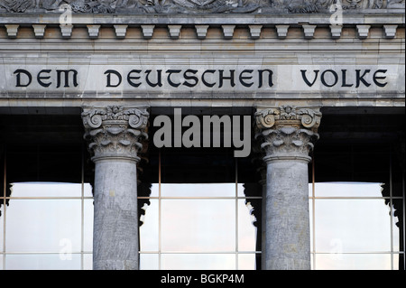 Inscription 'Dem Deutschen Volke', to the German people, and relief in the tympanum above the main entrance, Reichstag - Stock Photo