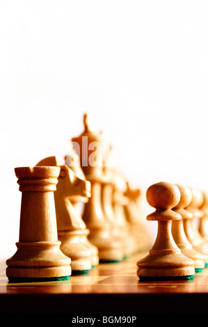 white chess pieces in starting position - Stock Photo