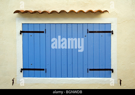 Blue wooden sunblinds / window shutters of traditional house, Banon, Alpes-de-Haute-Provence, Provence, France - Stock Photo