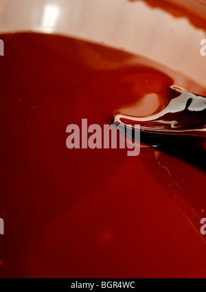 Melted chocolate with mixing spoon - Stock Photo