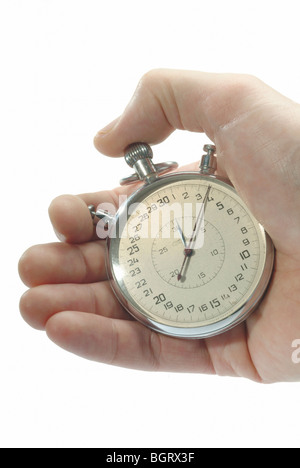 Hand holding a stop watch - Stock Photo