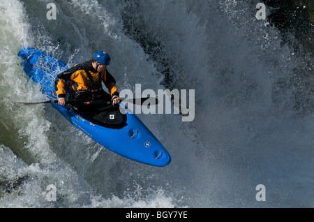 A kayaker drops a waterfall on the Deschutes River - Stock Photo