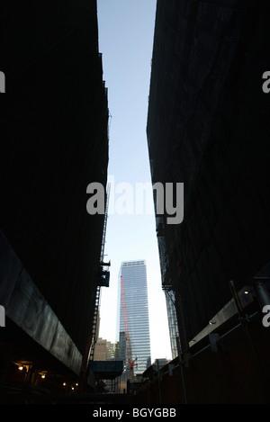 Buildings under construction, skyscraper in background - Stock Photo