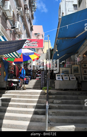 Ladder alleyway, with artwork and clothes shops, Stanley Market, Stanley (Chek Chue), Hong Kong, China - Stock Photo