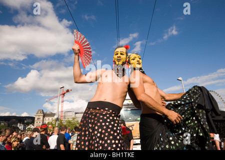 Two disguised men near Quai Bridge, Street Parade, the most attended technoparade in Europe, Zurich, Canton Zurich, - Stock Photo