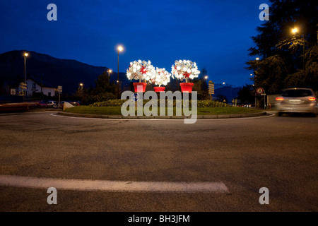 Roundabout decorated for Christmas in Annecy, France, photographed during early evening. - Stock Photo