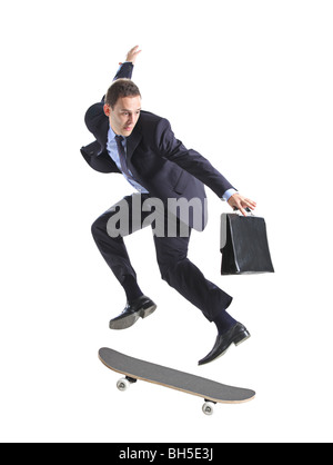 A businessman with skateboard jumping, isolated on a white background - Stock Photo