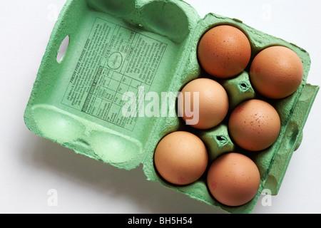 Egg box opened showing 6 free range large eggs from Marks & Spencer - Stock Photo