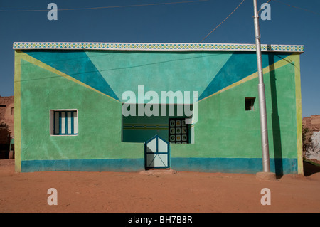 A colorful house in the desert village of Balat in Egypt's Dakhla Oasis. - Stock Photo