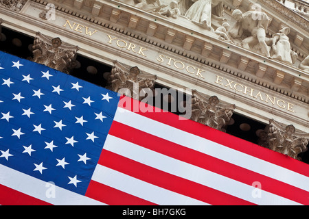 USA, New York City, Manhattan, Downtown Financial District - Wall Street and US flag hanging outside the New York - Stock Photo