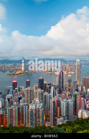 China, Hong Kong, Victoria Peak. View over Hong Kong from Victoria Peak. The illuminated skyline of Central sits - Stock Photo