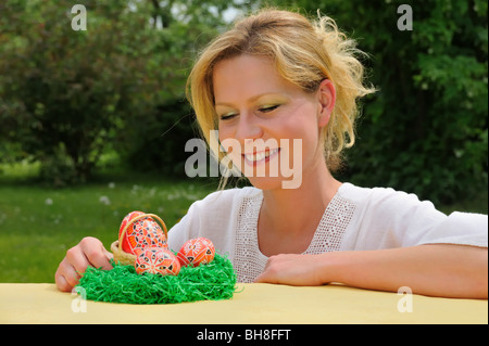 Young woman and easter eggs - Stockfoto