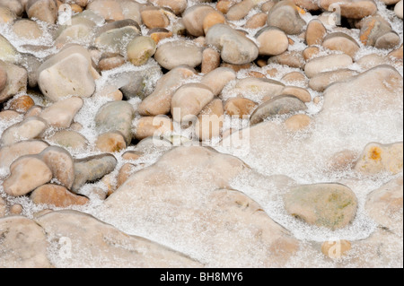 Lake Manitoba shoreline limestone rocks and pebbles coated with early winter ice, Steep Rock, Manitoba, Canada - Stock Photo