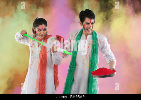Couple playing holi - Stock Photo