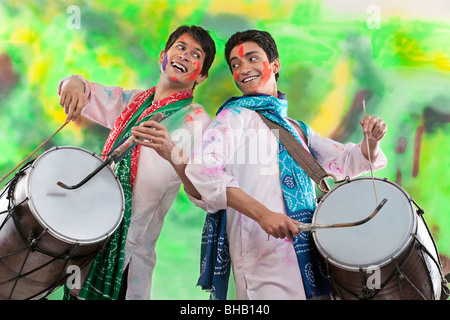 Two men playing on dholaks - Stock Photo
