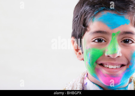Boy with holi colours on his face - Stock Photo