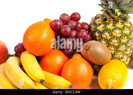 Very detailed image of a pile of delicious tropical fruits isolated on white - Stock Photo