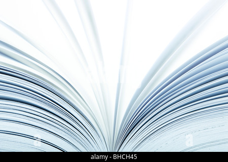 Macro of a open book with pages turning- selective focus - Stock Photo