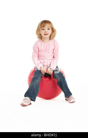 Young Girl Having Fun On Inflatable Hopper - Stockfoto